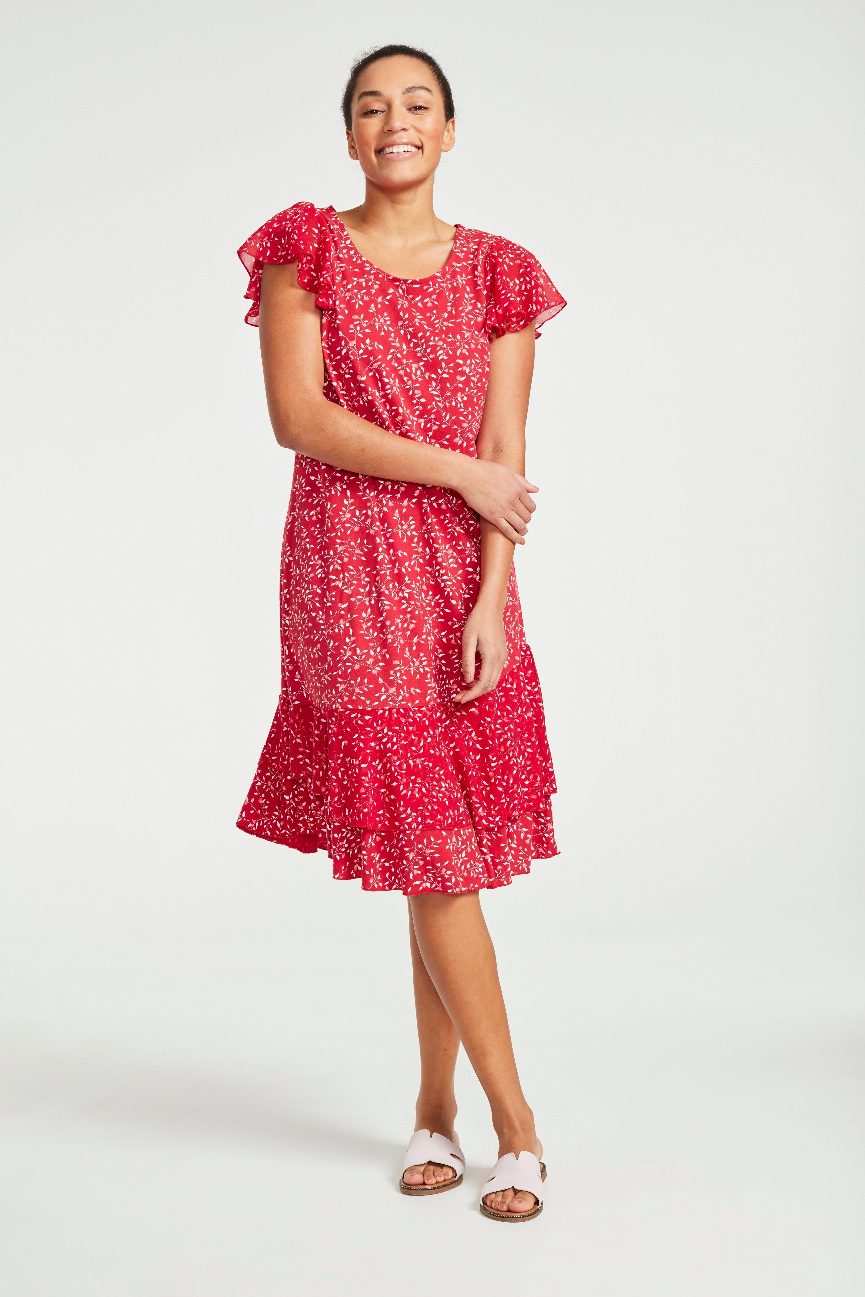 Wzorzysta sukienka zdżerseju we wzory zfalbankami